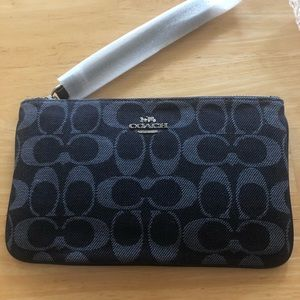 NWT Coach blue denim large wristlet.
